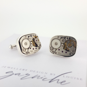 A pair of rectangular steampunk watch movement cufflinks