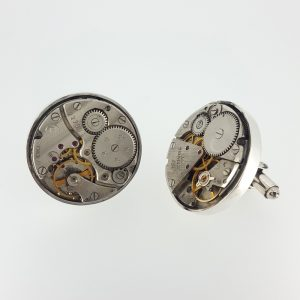 A pair of round steampunk watch movement cufflinks